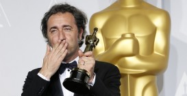 """Paolo Sorrentino, director of Italian film """"The Great Beauty"""" poses with his award for best foreign language film at the 86th Academy Awards in Hollywood"""